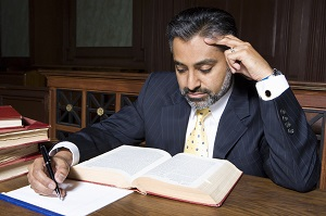 Man writing in court